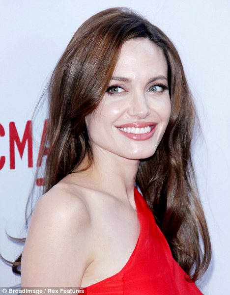Almost there: With her brown hair and blue eyes, Angelina Jolie possesses two of the British male