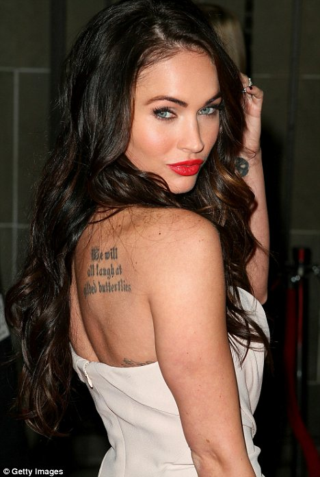 Fantasy figure: With her brown hair and light eyes, actress Megan Fox fits into the British male